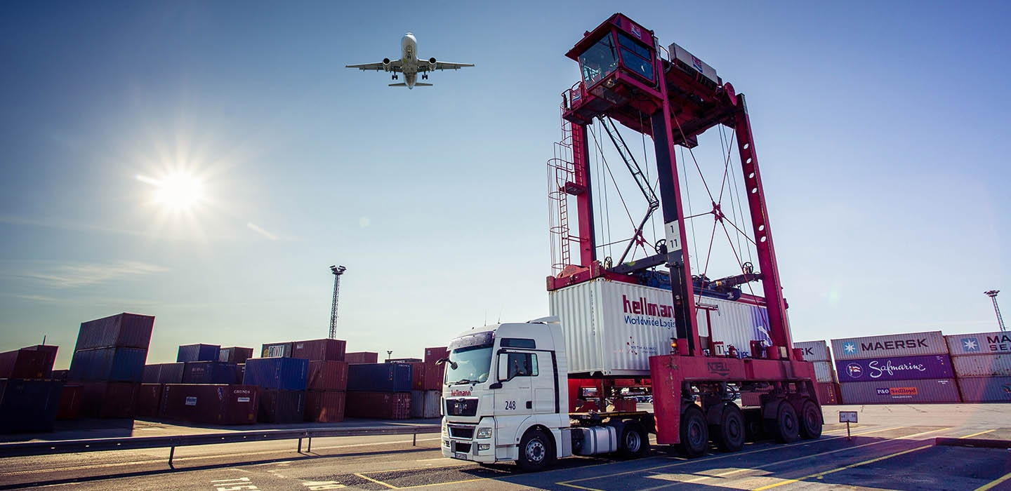 Truck with Seafreight Container unloading in Port with Plane